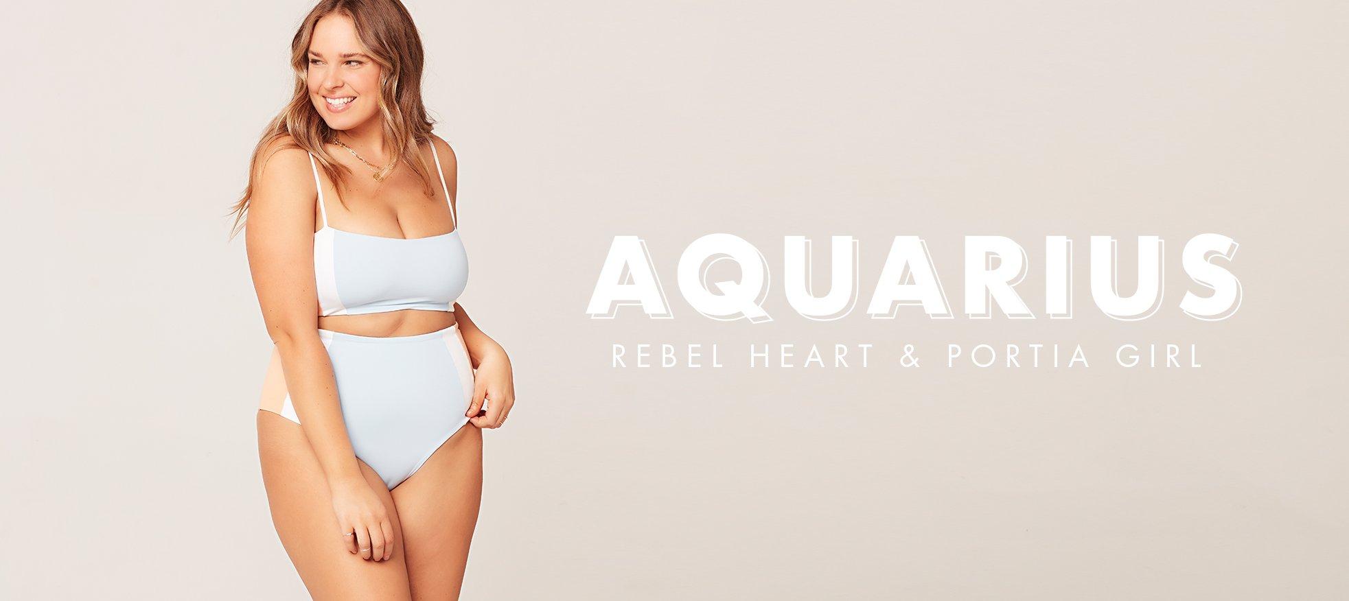 model wearing light blue rebel heart bikini top and portia girl high waist bikini bottom