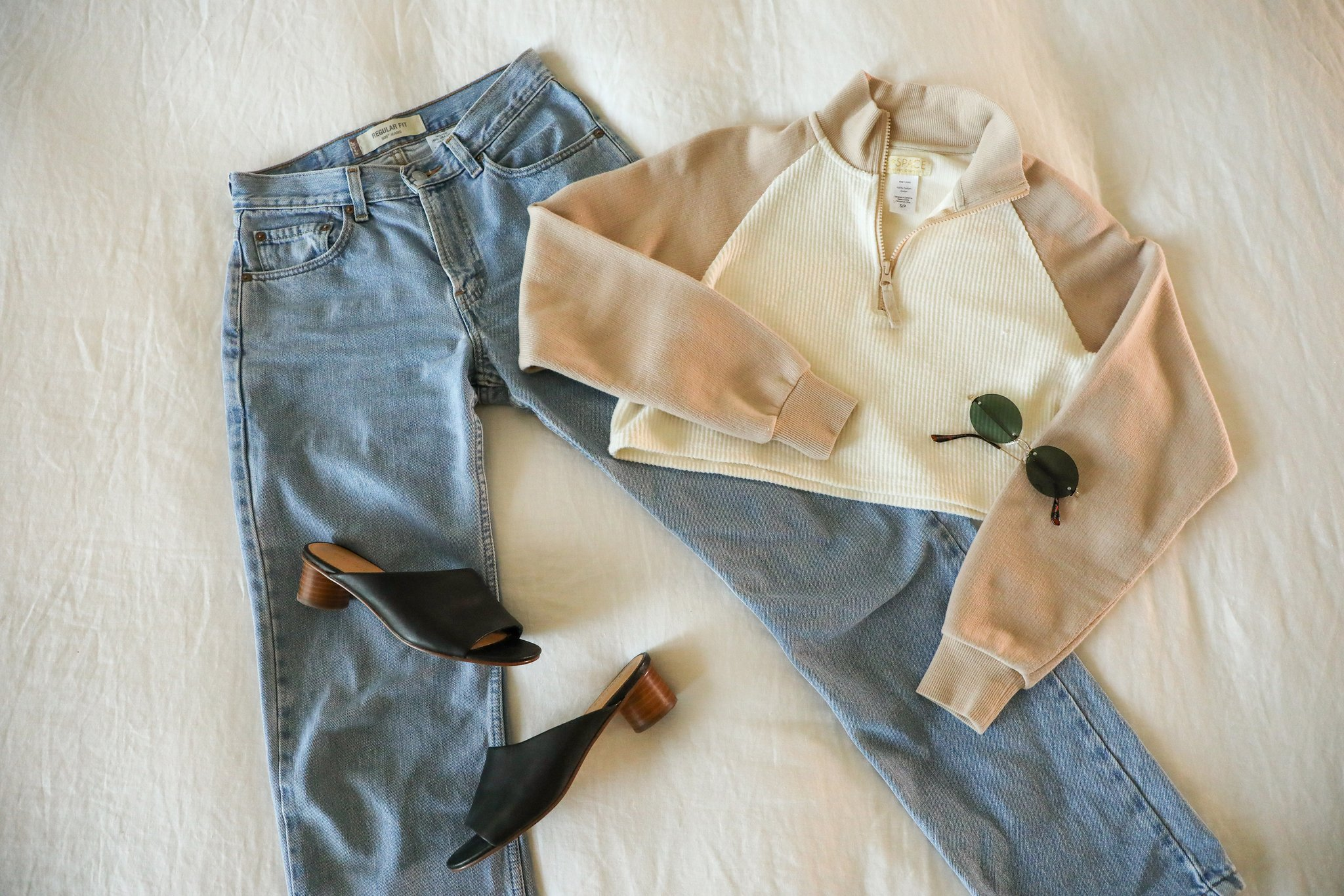 LSPACE Staycation pullover flat lay paired with jeans