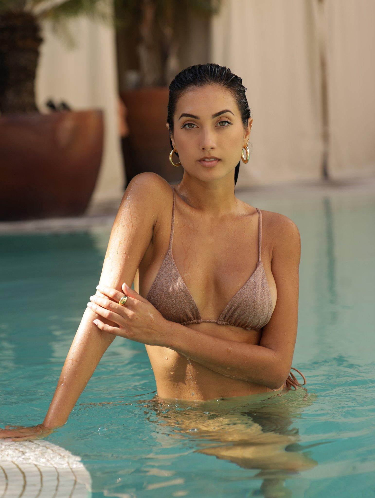 A woman in a pool wearing a bikini
