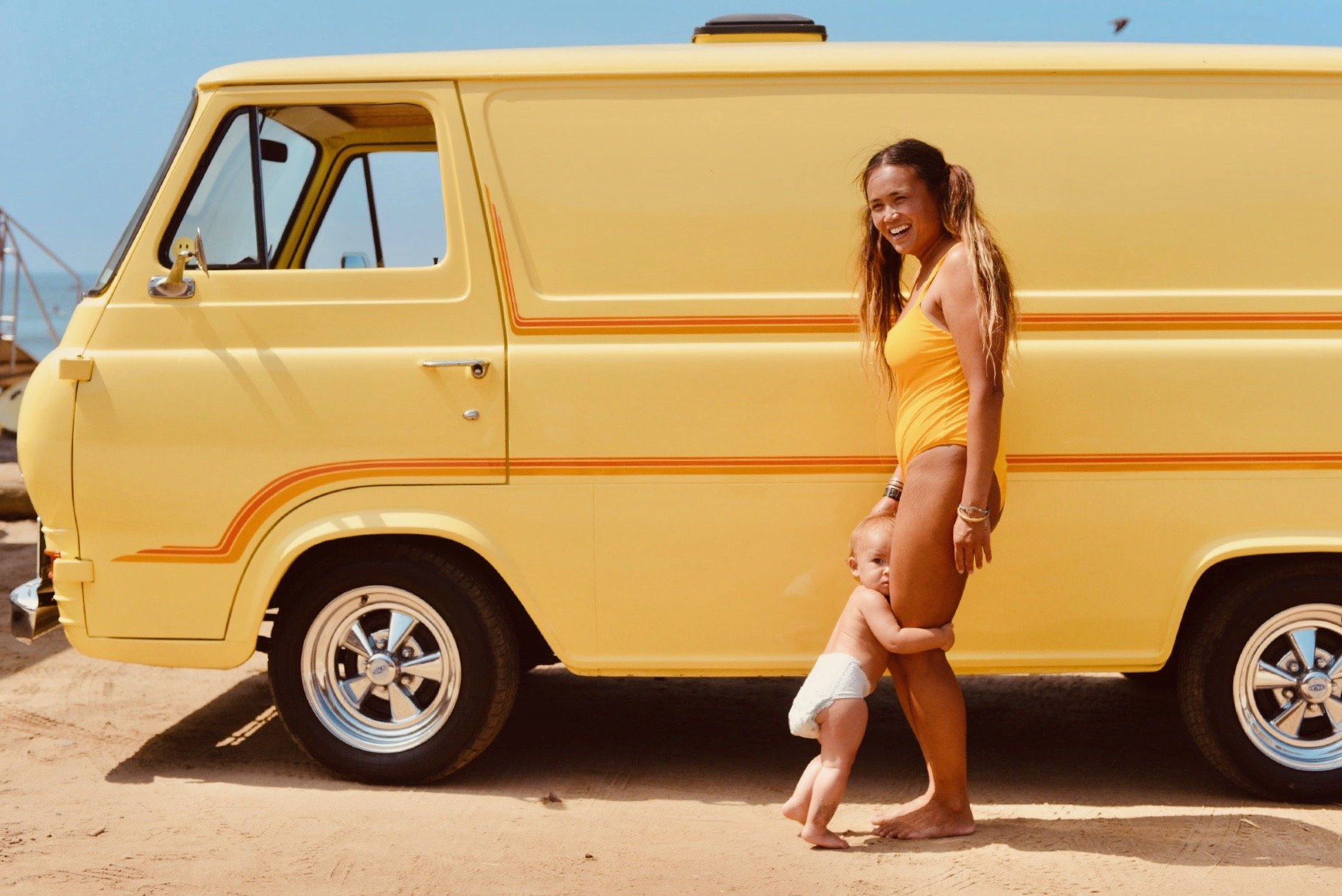 mom and child standing by a van