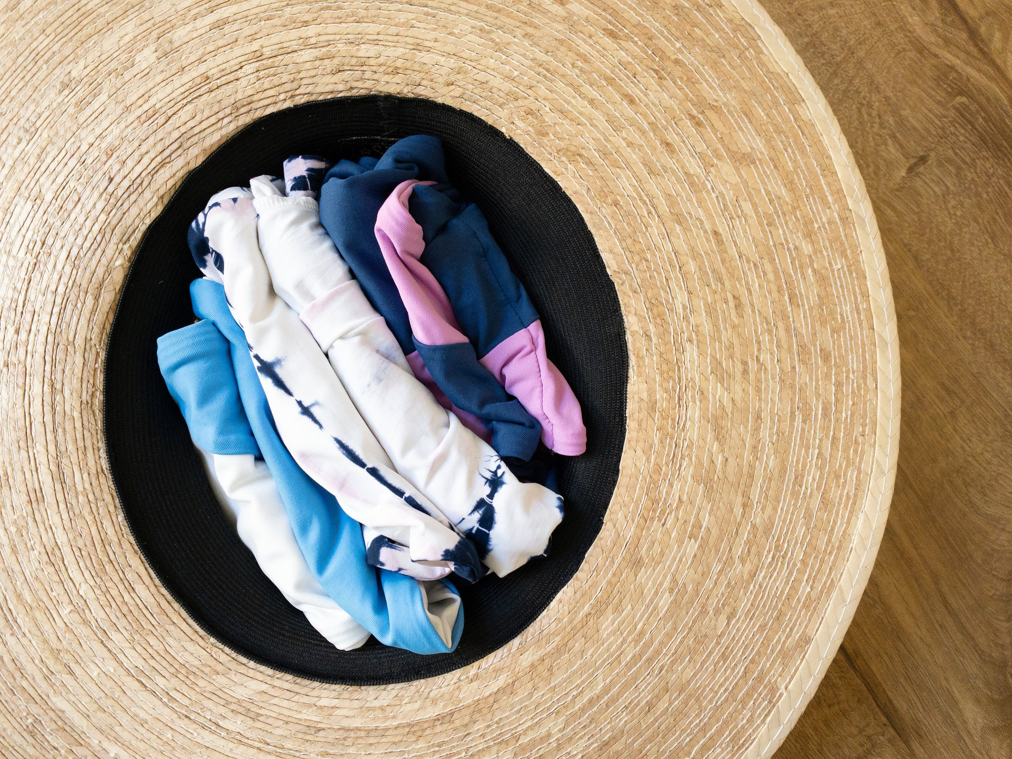 swimsuits folded in a hat
