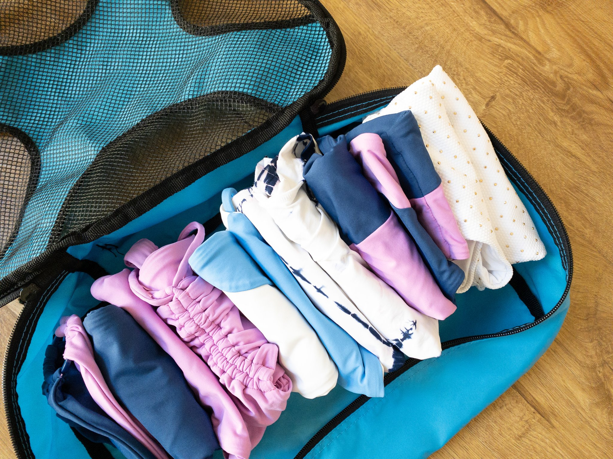 swimsuits folded in a packing cube